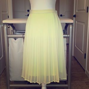 Lemon pleated midi skirt. Perfect for summer style